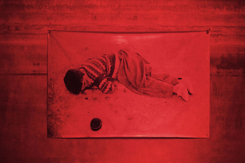 A photo of a boy killed during a gas attack in Halabja, Iraq, in 1988 by Saddam Hussein's forces hangs in a museum in Sulaimani, in memoriam to the more than 5,000 Kurds killed in the attacks.