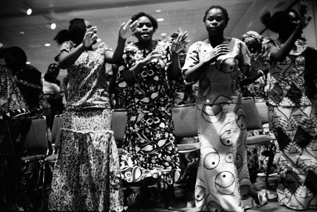 Members of Sunzu Noel's church dance and sing praises to the lord.