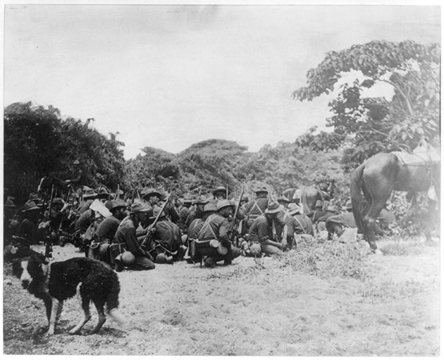 Sixth Infantry in San Juan creek bottom under Spanish fire from San Juan Hill, July 1, 1898.