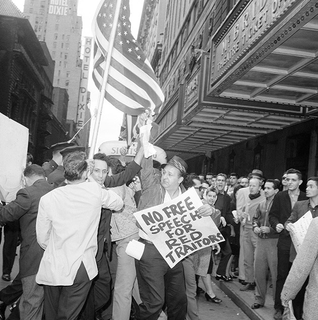 Police disperse anti-Castro demonstrators in New York's Times Square area, Sept. 15, 1963. Demonstrators, carrying placards and American flags, were protesting a nearby rally by students who returned from an unauthorized visit to Cuba.