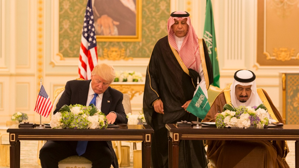 "President Donald Trump and King Salman bin Abdulaziz Al Saud of Saudi Arabia sign a ""joint strategic vision"" agreement in May"