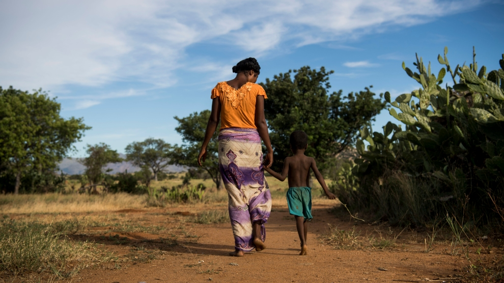 Nana, 24, walks back to her home in Betsingilo, Madagascar with her five-year-old son. She has two children and recently received a birth control implant from a Marie Stopes International mobile clinic.