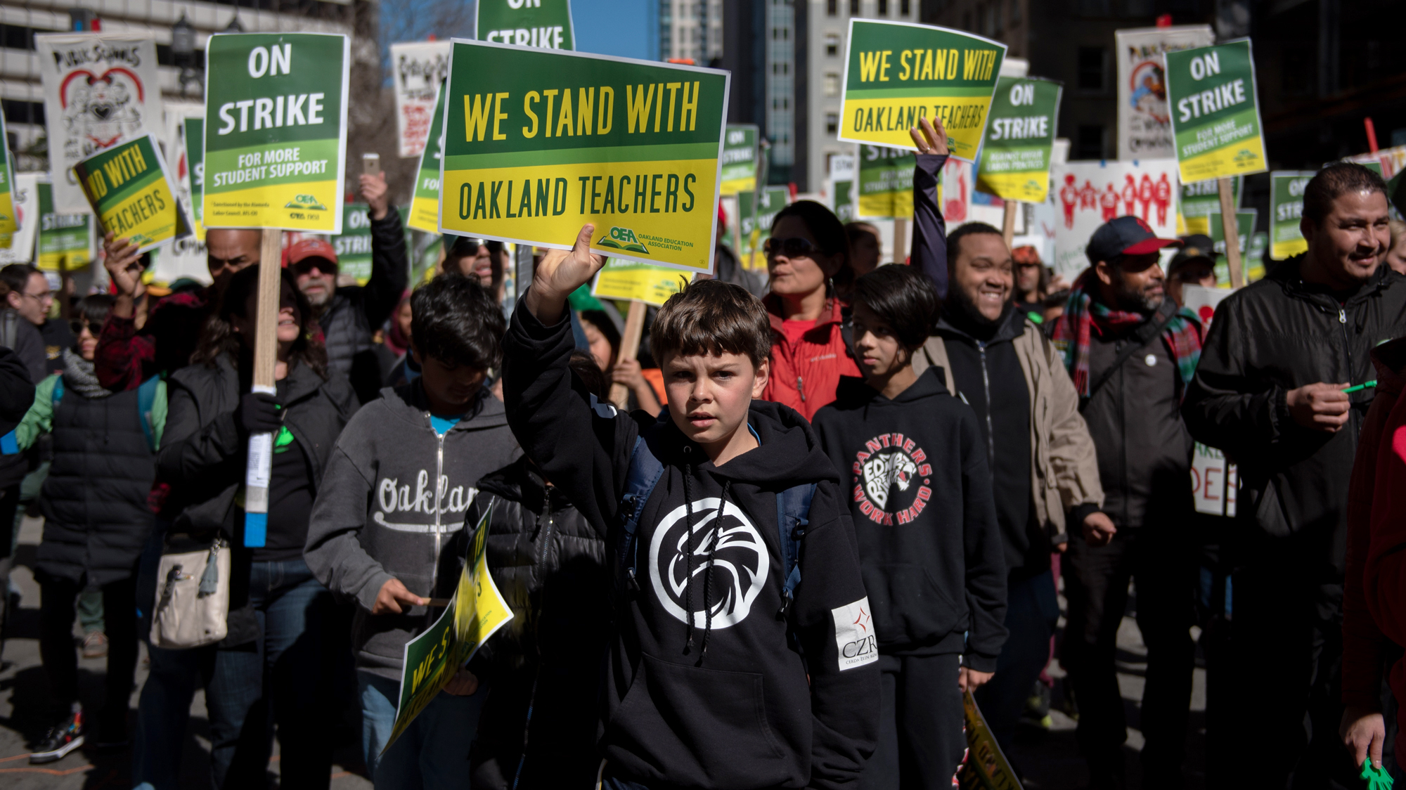 On the first day of a district-wide strike, students joined their teachers in Oakland, Calif., to demand higher wages for educators and more resources for public schools. Gabe, 10, holds a sign during the march in downtown Oakland.