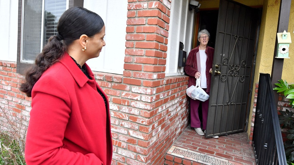 A woman delivers meals oh wheels meal