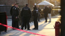 Police at the scene the morning after Adam Toledo was killed.
