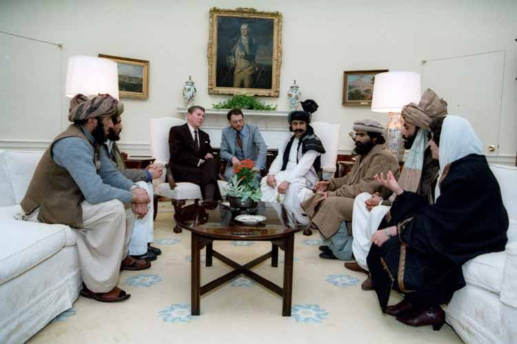 Reagan sitting with afghan freedom fighters