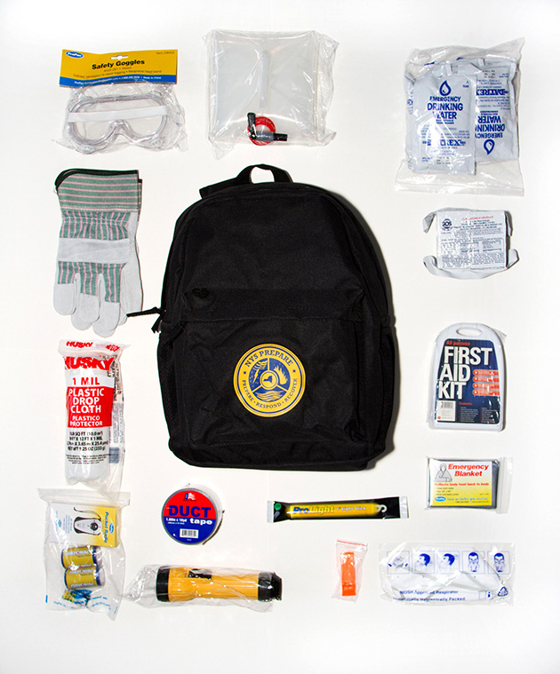 Simon's bag was prepared by Homeland Security and given to New   Yorkers after Hurricane Sandy.  In order to receive a bag you would attend a Saturday afternoon disaster preparedness seminar.  It includes safety goggles, duct tape, a whistle, MREs and water, and a first aid kit.