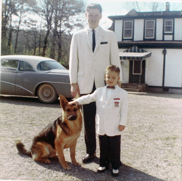 Bill and Roger Clinton with their dog, King, in front of their house on Park Avenue in Hot Springs, Arkansas, on Easter Sunday, 1962.