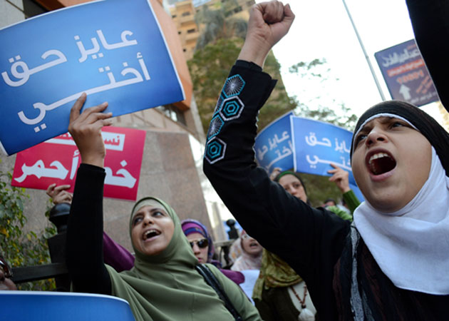 """Egyptian women protest the ruling military council's """"virginity tests"""" in December 2011.  Ayman Mose/ZUMA Press"""