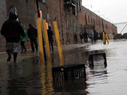 In Red Hook, a neighborhood along New York Harbor featuring low-lying land and industrial piers, sandbags weren't enough to prevent flooding, not just of seawater but also curious tourists, locals and television vans. James West