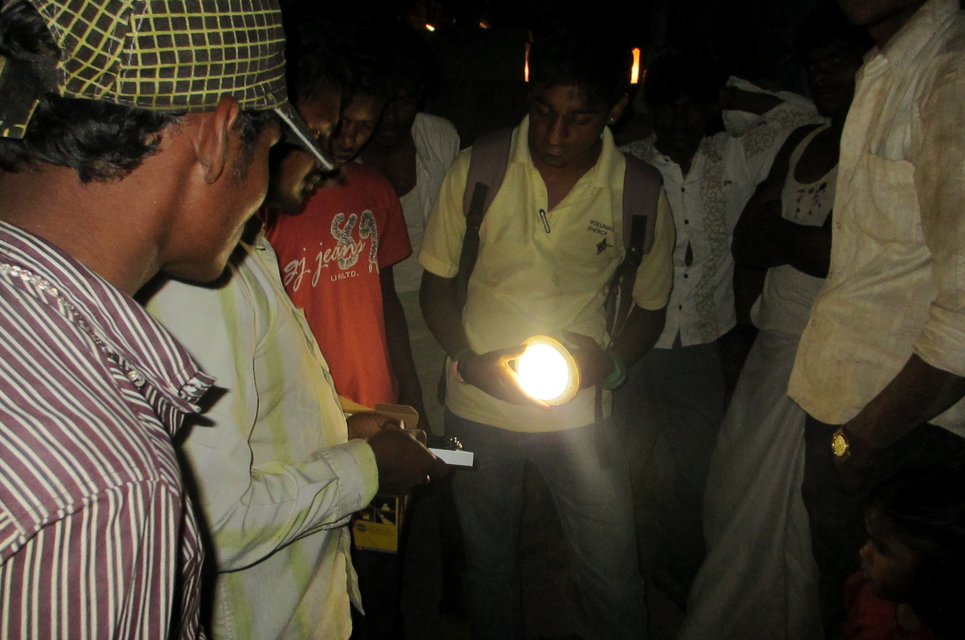 People holding a solar light