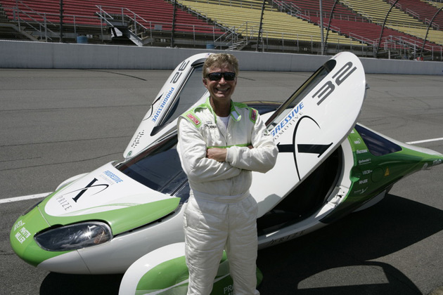 A team member with one of Edison2's Very Light Cars.